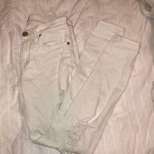 White ripped Express jeans